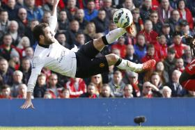 BEAUTY: Juan Mata scores a spectacular winner for Man United.
