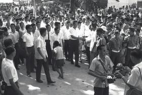 EARLY YEARS: Then Prime Minister Lee Kuan Yew shaking hands with residents during a tour of Punggol constituency in 1965.