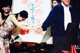 OOPS! Sharon Au holding on to Mr Lee Kuan Yew's hand after shaking it at the Speak Mandarin Campaign event. She recalls Mr Lee burst out laughing at her gaffe.