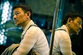 DISHEVELLED: To prepare for his role as a poor farmer, Andy Lau let his facial hair grow out and got a tan.