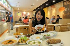 FEAST: Suria actress-host Nurul Aini eating at Encik Tan Popiah Oyster omelette Fried carrot cake