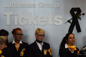 Employees of the German airline Lufthansa observe a minute of silence on Thursday to pay tribute to the victims of the Germanwings airplane crash