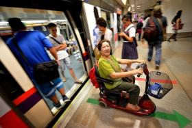 CONVENIENT: The mobility scooter allows Madam Elsie Tan to move about on her own without having to rely on her husband.