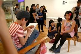 TALENTED: Student Trisha Tan (above) was Mondo Okumura's first subject last Friday at the launch of his art exhibition at curatorial space K+.