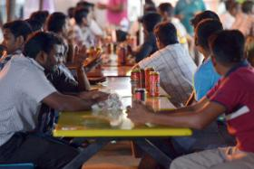 People having drinks near Kerbau Road following the change in restrictions under the alcohol ban that was imposed after the 8 December riot in Little India.