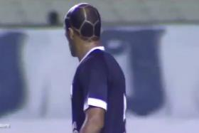 Ratinho's hairstyle featured hexagon panels shaved into his head to resemble a football