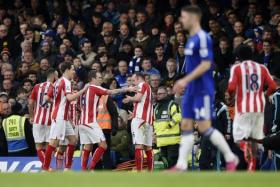 Charlie Adam celebrates with team mates after scoring his stunner for Stoke.