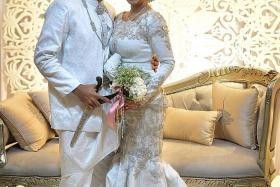 WEDDED BLISS: Popular singer-songwriter Taufik Batisah and his wife Sheena Akbal tied the knot at a wedding reception with some 3,000 guests. He serenaded his wife with his song Hanya Kamu, which he had written for her.
