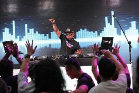 TOP DJS: Partygoers having a great time at Kallang Wave Mall as they dance to the infectious beats spun by 50 top local DJs.
