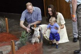 NAME GAME: Prince William and Kate Middleton with their firstborn Prince George.