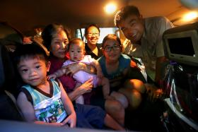 ENTHUSIASTIC: Mr Ng We Keat and his wife, Madam Sam Chiew Mun, with their children Amanda, 12, three-year-old Wyatt, seven-month-old Nicole, and the childrens' grandaunt, Mrs Ng Guan Choo.