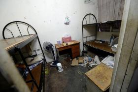 MESSY: One of the 13 rooms in the three-storey house that Mr Chen, a Chinese national, lived in. All of them had bunk beds.