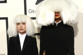PERFECT COMBO: Sia (right) and Maddie Ziegler at the Grammy Awards in Los Angeles, California, on Feb 8.