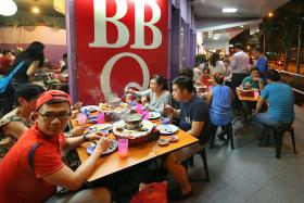 CALM: Business for hotpot eateries along Beach Road and Liang Seah Street was still busy yesterday evening.
