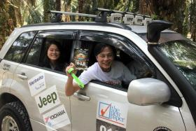 FAMILY FUN: Mr Vincent Low and his 17-year-old daughter Unica at last year's TNP SUVival Challenge.