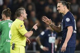 Zlatan Ibrahimovic speaks with a referee on Wednesday during a French Cup semi-final between Paris Saint-Germain and Saint-Etienne