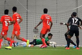 """""""Of course, I'm very happy with the clean sheet but everyone contributed to this result."""" - LionsXII goalkeeper Izwan Mahbud (left, in green), who was unbeatable last night."""