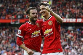 UP AND DOWN: United's Juan Mata (far left) and Ander Herrera (near left) form a superb partnership, while City's Yaya Toure appear past his sell-by date.