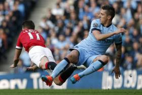 The 2014/15 season has not gone too well for Manchester United's Adnan Januzaj (left) and City's Stevan Jovetic.