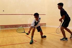EASY WIN: RI's Tan Hua Wang (in white) getting the better of ACS (I) captain Randall Yeo.