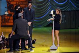 Actress Jennifer Lopez accepts the Best Scared as S*** award from Channing Tatum (left), Adam Rodriguez (center), Matt Bomer and Joe Manganiello (right) during the 2015 MTV Movie Awards in Los Angeles, California April 12, 2015.