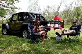 ENHANCED: Mr Paul McLean with his wife, Ms Emilia Sahatapy, enjoying their Jeep's Jungle Bar.