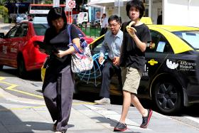 Teenage blogger Amos Yee Pang Sang arriving at court for his pre-trial conference on Friday (April 17).