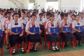 Thai students are encouraged to sew their GPA scores onto their uniforms.