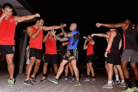 PACKING A PUNCH: Singapore rugby sevens team practising muay thai to learn how to outmanoeuvretheir opponents in June's SEA Games.