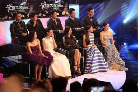STARS: Rui En (front row in black dress) wore an annoyed expression while sitting on stage with other stars like (front row from left) Felicia Chin, Kimberly Chia, Jeanette Aw and Rebecca Lim. (Back row, left to right) Xu Bin, Zhang Zhen Huan, Romeo Tan, Elvin Ng, and Aloysius Pang.
