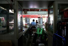 """""""I've lived in this area since young, and I'm sad to see it go, but what to do?"""" - Mr Koh Aik Hock, who runs a convenience store at Transit Road (above)"""