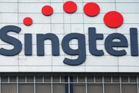 Singtel signage at their head office in Singapore. Users flooded social media complaining that they are unable to use their data services.