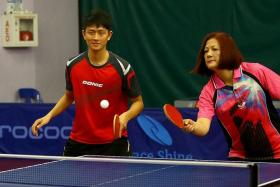 A FAMILY THAT PLAYS TOGETHER: Clarence Chew (in red) playing table tennis with his mum (in pink), youngest sister Cassandra and dad.