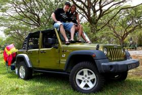 HOPEFUL: Jeep Owners' Club Singapore president Paul McLean, pictured with his wife Emilia Sahatapy, hopes that at least one of the Jeeps will finish first at The New Paper SUVival Challenge.