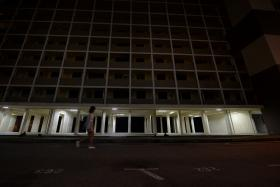 QUIET: The short-cut route to Commonwealth MRT station takes pedestrians past vacant blocks of flats.