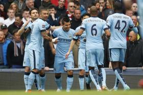 Manchester City's Sergio Aguero celebrates scoring their first goal