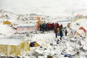 CHECKING STATUS: A climbing team doing a headcount at Everest Base Camp after the avalanche.