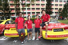 """RED TIDE: Silat exponent Sheik Ferdous, floorball players Jowie Tan and Sharifah Bariyah, and sprinter Calvin Kang pose on two of the 250 taxis that have been wrapped in red as part of the """"Paint the Town Red"""" movement."""
