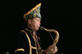 Saxophonist Phillipus Jani was entertaining leaders around the region at the 26th Asean Summit in KL.