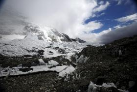 STUCK: Some trekkers were stranded on Mount Everest (above) when the avalanche hit but one Singaporean team managed to descend to safety. Many Nepalese are feared to be trapped under the rubble.