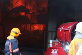 SCDF's officers battling the fire at Joo Kon on Tusday (April 28)