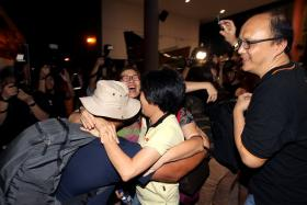 Jubilant scenes at Paya Lebar Airbase as the first batch of Singaporeans arrived safely in Singapore