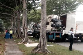 FATAL: A 32-year-old man was found trapped in the passenger seat of a lorry that crashed into a trailer on Changi Coast Road.