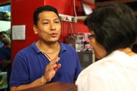 DISTRESSED: Mr Tom Shrestha had to turn away donors who turned up at his restaurant with donations.