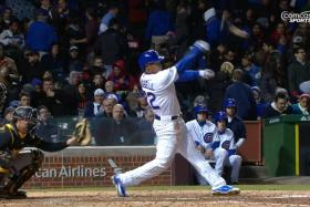 Chicago Cubs rookie Addison Russell loses control of his bat during the seventh inning of their match against the Pittsburgh Pirates.