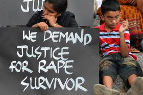 File picture of activists from various women's rights organisations and children in India staging a silent demonstration against sexual assault and rapes on women this month