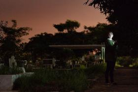 CHALLENGING: The reporter during her assignment to last a night at a cemetery.