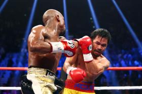 Floyd Mayweather and Manny Pacquiao box during their world welterweight championship bout at MGM Grand Garden Arena.