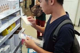 SUPPLIES: Mr Brandon Chia (above), 22, buying medical supplies at Singapore General Hospital for a medical relief trip to Nepal tomorrow.