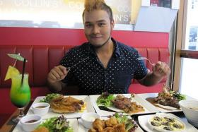 LOADING UP ON PROTEIN: DJ Joshua Simon having lunch at Collin's Grille Bento at King George's Avenue.